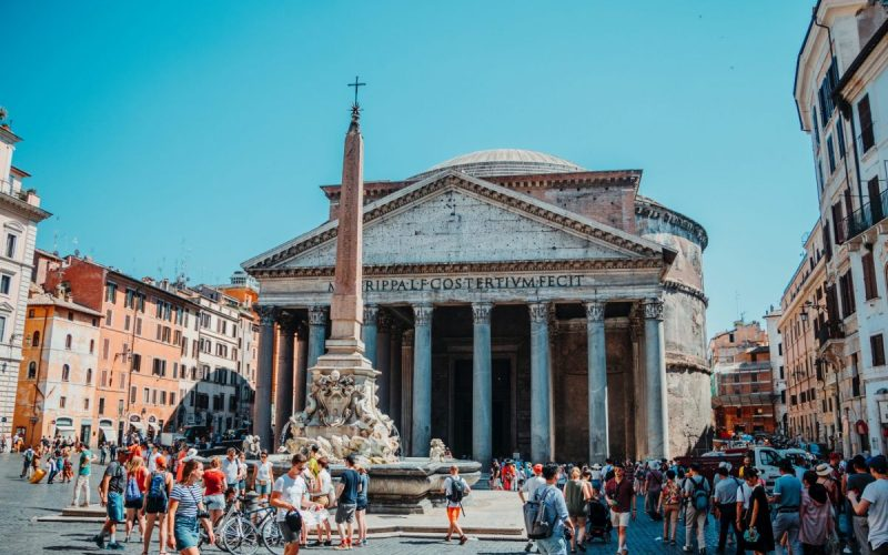 photo-of-people-walking-in-front-of-pantheon-roman-temple-in-2676602
